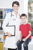 Pediatrician and brave patient Stock Photos