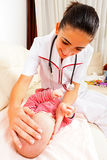 Pediatrician checking baby Stock Photos
