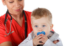 Pediatrician and child Stock Image