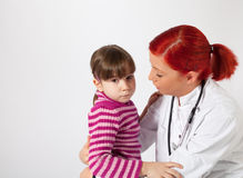 The pediatrician comforted a little girl Royalty Free Stock Photo