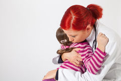 The pediatrician comforted a little girl Royalty Free Stock Image