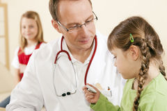 Pediatrician doctor with child patient Stock Photos