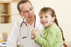 Pediatrician doctor with child patient Royalty Free Stock Photography