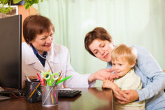 Pediatrician doctor examing baby Royalty Free Stock Photo
