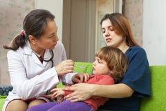 Pediatrician doctor examining  baby Stock Photos