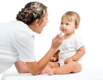 Pediatrician doctor examining baby girl Stock Image