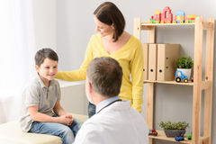 Pediatrician doctor examining child stock images