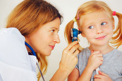 Pediatrician doctor examining girl Stock Photography