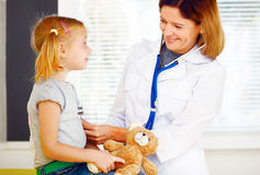 Pediatrician doctor examining little girl. Stock Photography