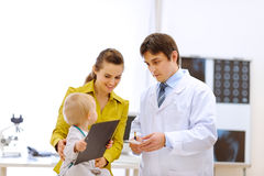 Pediatrician doctor explaining something to mother Stock Photography