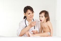 Pediatrician doctor give medicine Stock Photos