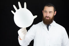 Pediatrician doctor holding glove. Stock Photos