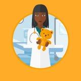 Pediatrician doctor holding teddy bear. Royalty Free Stock Photography