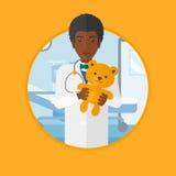 Pediatrician doctor holding teddy bear. Royalty Free Stock Photo