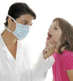 Pediatrician doctor with a little patient Stock Photography