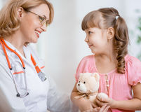 Pediatrician doctor talking with kid Stock Image