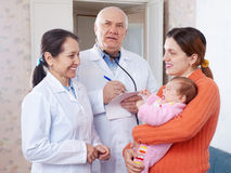 Pediatrician doctors examining little baby Royalty Free Stock Photos