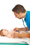 Pediatrician examine baby Stock Images