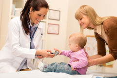 Pediatrician examine baby with stethoscope Stock Photo