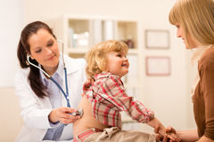 Pediatrician examine child girl with stethoscope royalty free stock photography