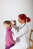 The pediatrician examines the head of a little girl Stock Image