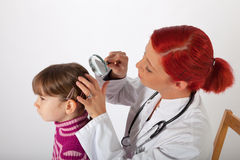 The pediatrician examines the head of a little girl Royalty Free Stock Photo