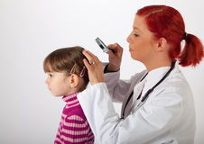 The pediatrician examines the head of a little girl Stock Photos