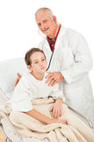 Pediatrician Examines Little Boy Stock Image