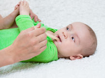 Pediatrician examines a newborn baby with a spatula Royalty Free Stock Image