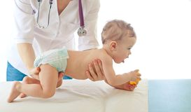 Pediatrician examining baby . Stock Images