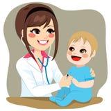 Pediatrician Examining Baby Stock Photography