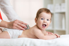 Pediatrician examining baby. Doctor using Stock Photography