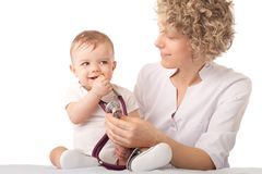 Pediatrician examining baby with stethoscope. Royalty Free Stock Images