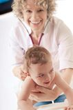 Pediatrician examining baby with stethoscope. Stock Photo