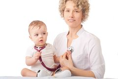 Pediatrician examining baby with stethoscope. Royalty Free Stock Image