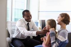 Pediatrician Examining Child In Hospital Royalty Free Stock Image