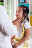 Pediatrician examining lymph nodes Royalty Free Stock Images
