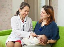 Pediatrician  examining newborn baby Royalty Free Stock Images