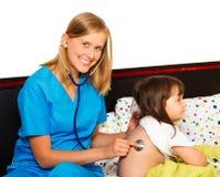 Pediatrician Examining Royalty Free Stock Images