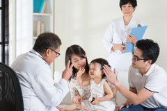 Pediatrician. Family consult pediatrician. Doctor and patient healthcare concept Royalty Free Stock Image