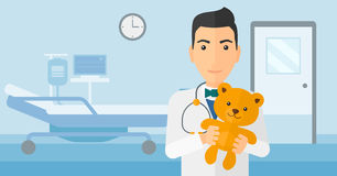 Pediatrician holding teddy bear. Royalty Free Stock Photos
