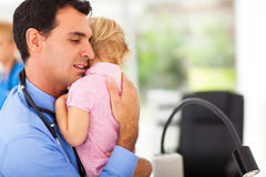 Pediatrician hugging baby Stock Photos