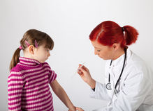 The pediatrician inoculating a small girl Stock Photos