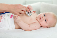 Pediatrician inspection of little baby Stock Images