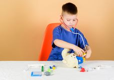 Pediatrician intern. little boy in medical uniform. kid doctor with stethoscope. Treatment prescription. nurse. Laboratory assistant. family doctor. hospital royalty free stock photos
