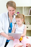 Pediatrician and little girl Stock Photography