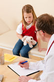 Pediatrician with little patient in his surgery Stock Photos