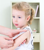 Pediatrician measuring toddler's forearm Royalty Free Stock Photos