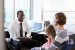 Pediatrician Meeting With Mother And Child In Hospital Stock Images