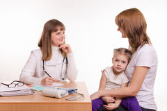 Pediatrician in office talking with my mother sick child Royalty Free Stock Photography